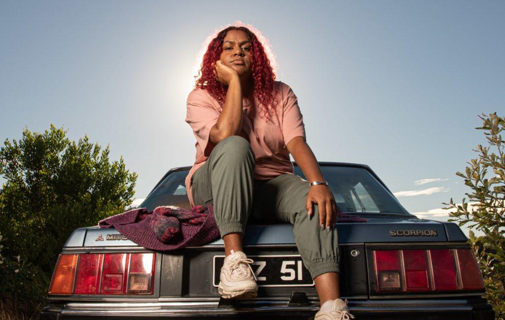 Miiesha on boot of vehicle